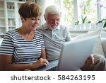 senior couple sitting on sofa... | Shutterstock . vector #584263195