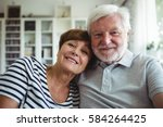 portrait of senior couple... | Shutterstock . vector #584264425