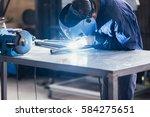 unrecognizable worker welding... | Shutterstock . vector #584275651