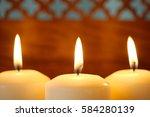 Macro Of Three Burning Candles...