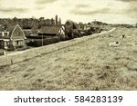 sheep grazing on protective dam ...   Shutterstock . vector #584283139