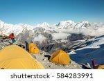 orange tents of high altitude... | Shutterstock . vector #584283991
