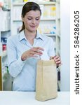 Pharmacists Packing Medicine I...