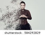 Small photo of Woman in steampunk costume. Disintegration, photo manipulation