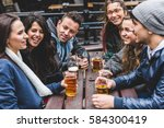 group of friends enjoying a... | Shutterstock . vector #584300419