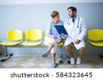doctor and patient discussing... | Shutterstock . vector #584323645