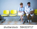 doctor and patient discussing... | Shutterstock . vector #584323717