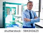 portrait of doctor standing... | Shutterstock . vector #584343625