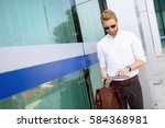 businessman using tablet... | Shutterstock . vector #584368981