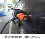 refueling cars | Shutterstock . vector #584389117