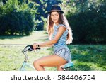 nice girl with curly hair...   Shutterstock . vector #584406754