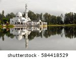 reflection of a floating white... | Shutterstock . vector #584418529