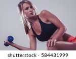 bodybuilding. strong fit woman... | Shutterstock . vector #584431999