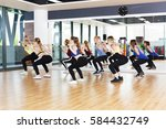 squats with weights on training.... | Shutterstock . vector #584432749