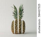 sliced pineapple on bright... | Shutterstock . vector #584437525