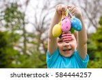 different color easter eggs in... | Shutterstock . vector #584444257