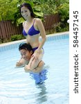 couple in swimming pool  woman... | Shutterstock . vector #584457145