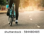 woman on a bicycle on a road in ... | Shutterstock . vector #584480485