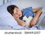 young caucasian child has belly ... | Shutterstock . vector #584491057