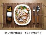 crispy noodles in creamy sauce... | Shutterstock . vector #584495944