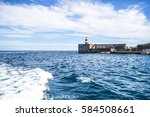 port entrance with lighthouse | Shutterstock . vector #584508661