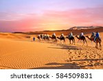 camel caravan going through the ... | Shutterstock . vector #584509831