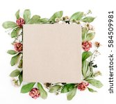 Stock photo craft gift box and floral composition with red roses and green leaves on white background flat lay 584509981