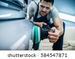 man doing a car polish with a... | Shutterstock . vector #584547871