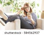 full length shot of a smiling... | Shutterstock . vector #584562937