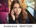 young female student is calling ... | Shutterstock . vector #584572285