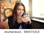 beautiful young hipster girl... | Shutterstock . vector #584572315