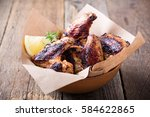 smoky barbecued chicken wings... | Shutterstock . vector #584622865