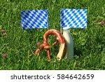 fresh cow milk and pretzel on a ... | Shutterstock . vector #584642659