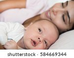 young mother with her baby in... | Shutterstock . vector #584669344