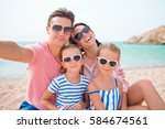 young beautiful family taking... | Shutterstock . vector #584674561