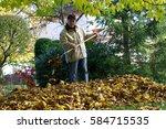 Man Burrowing Autumnal Fallen...