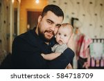 portrait of young happy father... | Shutterstock . vector #584718709