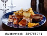roasted sucking pig with potato ... | Shutterstock . vector #584755741