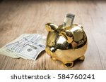 putting a 100 dollars into a... | Shutterstock . vector #584760241
