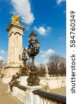Small photo of Bronze lamps on Alexander III Bridge, Paris, France.
