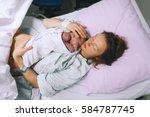 mother holding her newborn baby ...   Shutterstock . vector #584787745