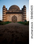Early morning sun brightens the entrance of the Golgumbaz, a Mughal mausoleum in Bijapur, India. - stock photo