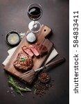 grilled ribeye beef steak with... | Shutterstock . vector #584833411