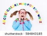happy preschool child learning... | Shutterstock . vector #584843185