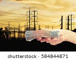 hand hold money with electric...   Shutterstock . vector #584844871
