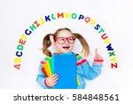 happy preschool child learning... | Shutterstock . vector #584848561