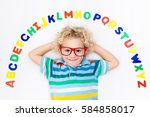 happy preschool child learning... | Shutterstock . vector #584858017