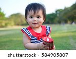 Cute Baby Girl Playing In The...