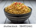 instant noodles in the bowl on... | Shutterstock . vector #584951461