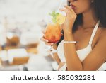 young woman with coctail on the ... | Shutterstock . vector #585032281